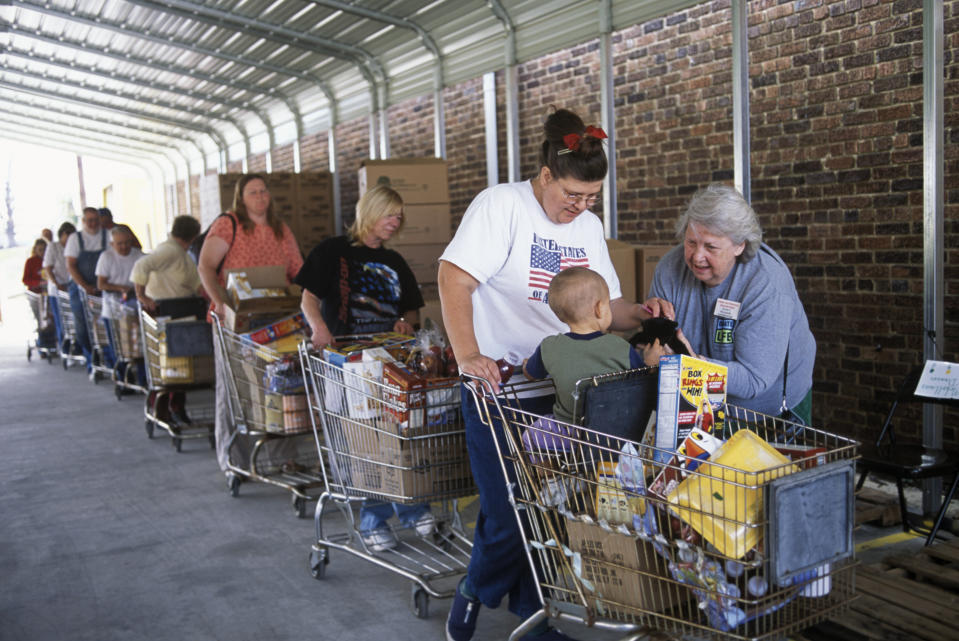 People stand in line with carts filled with groceries at the foodbank in McArthur, Ohio.