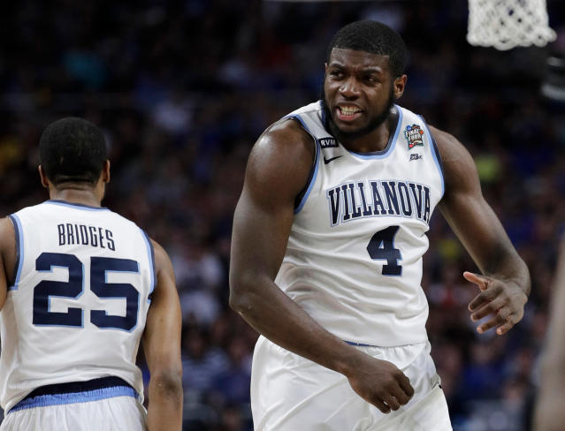 Villanova's Eric Paschall (4) reacts during the first half in the semifinals of the Final Four NCAA college basketball tournament against Kansas, Saturday, March 31, 2018, in San Antonio. (AP Photo/David J. Phillip)