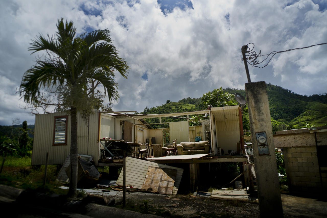 A home that was abandoned after Hurricane Maria hit one year ago stands full of furniture in the San Lorenzo neighborhood of Morovis, Puerto Rico, Spet. 8, 2018. Puerto Ricans living below the poverty line were pushed to the brink of despair by the storm, struggling for food, housing and medicine. (Photo: Ramon Espinosa/AP)
