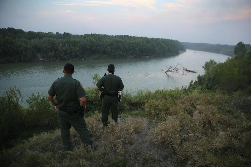 US Border Patrol agents look for immigrants crossing the Rio Grande from Mexico to the United States near Mission, Texas, on July 24, 2014