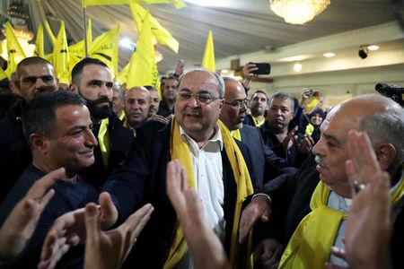 FILE PHOTO: Ahmad Tibi, leader of the Ta'al party faction, is surrounded by supporters during an election campaign event in the Wadi Ara, in northern Israel February 2, 2019. Picture taken February 2, 2019. REUTERS/Ammar Awad/File Photo