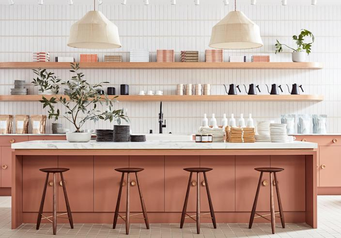 Custom counter stools by Oja Design—a local, San Francisco-based woodworker—pair with the kitchen's dusty peach cabinetry, which is painted in Benjamin Moore's Fox Run. The pendants are by the Future Perfect.