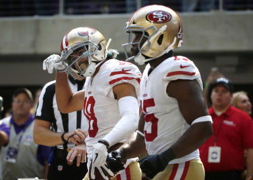 San Francisco 49ers wide receiver Dante Pettis, left, celebrates with teammate Pierre Garcon, right, after catching a 22-yard touchdown pass during the second half of an NFL football game against the Minnesota Vikings, Sunday, Sept. 9, 2018, in Minneapolis. (AP Photo/Bruce Kluckhohn)