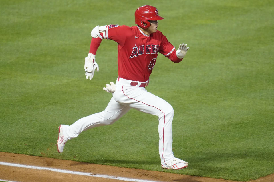 Los Angeles Angels designated hitter Shohei Ohtani runs to first base as he grounds out during the fourth inning of a baseball game against the Minnesota Twins Friday, April 16, 2021, in Anaheim, Calif. (AP Photo/Marcio Jose Sanchez)