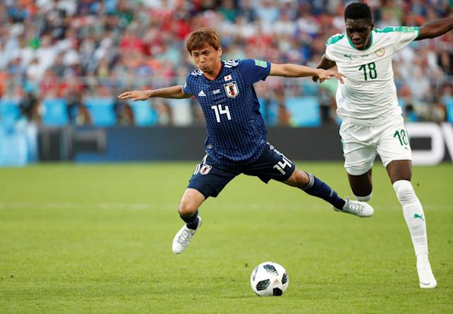 Soccer Football - World Cup - Group H - Japan vs Senegal - Ekaterinburg Arena, Yekaterinburg, Russia - June 24, 2018 Japan's Takashi Inui in action with Senegal's Ismaila Sarr REUTERS/Max Rossi