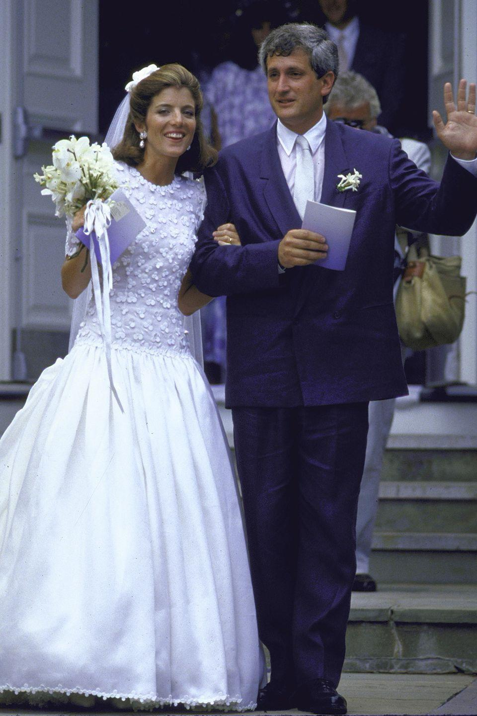 <p>The former first daughter wore a white silk organza dress by Carolina Herrera to marry Edwin Schlossberg in Massachusetts. Featuring a long bodice embroidered with white shamrocks to incorporate her father's Irish heritage, the gown's skirt had a 25-foot train.</p>