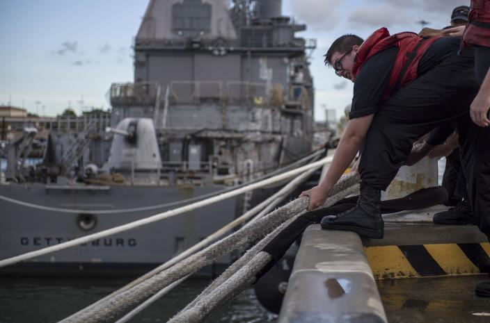 <p>A sailor heaves line during a heavy weather mooring evolution in preparation for Hurricane Florence on Sept. 11, 2018 in Norfolk, Va. Some ships will not get underway due to maintenance and are taking extra precautions to avoid potential damage. Commanding officers have a number of options when staying in port. Some of these options include adding additional mooring and storm lines, dropping the anchor, and disconnecting shore power cables. (Photo: Mass Communication Specialist 2nd Class Justin Wolpert/U.S. Navy via Getty Images) </p>