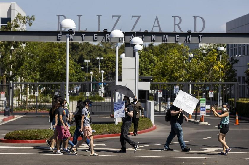 Irvine, CA - July 28: Several hundred Activision Blizzard employees stage a walkout which they say is in a response from company leadership to a lawsuit highlighting alleged harassment, inequality, and more within the company outside the gate at Activision Blizzard headquarters on Wednesday, July 28, 2021 in Irvine, CA. (Allen J. Schaben / Los Angeles Times)