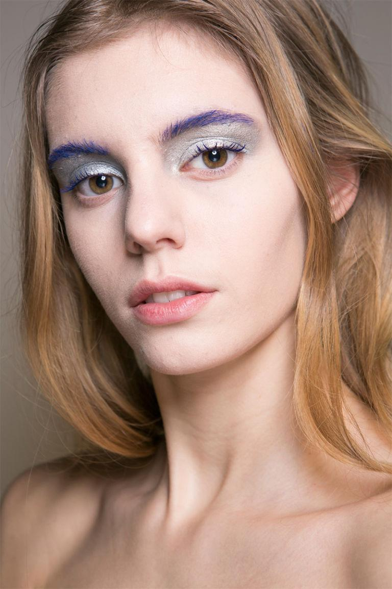 <p>We never thought purple eyebrows could look so delicate, seen backstage at C Saint Martins.</p>