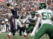 FILE - In this Sept. 22, 2019, file photo, New England Patriots quarterback Tom Brady prepares to throw a touchdown pass to Julian Edelman in the first half of an NFL football game against the New York Jets, in Foxborough, Mass. The 6-foot-4 Brady loomed large in the AFC East for two decades, dominating the Miami Dolphins and the other perennial also-rans, the Buffalo Bills and New York Jets. And now he's gone. (AP Photo/Steven Senne, FIle)