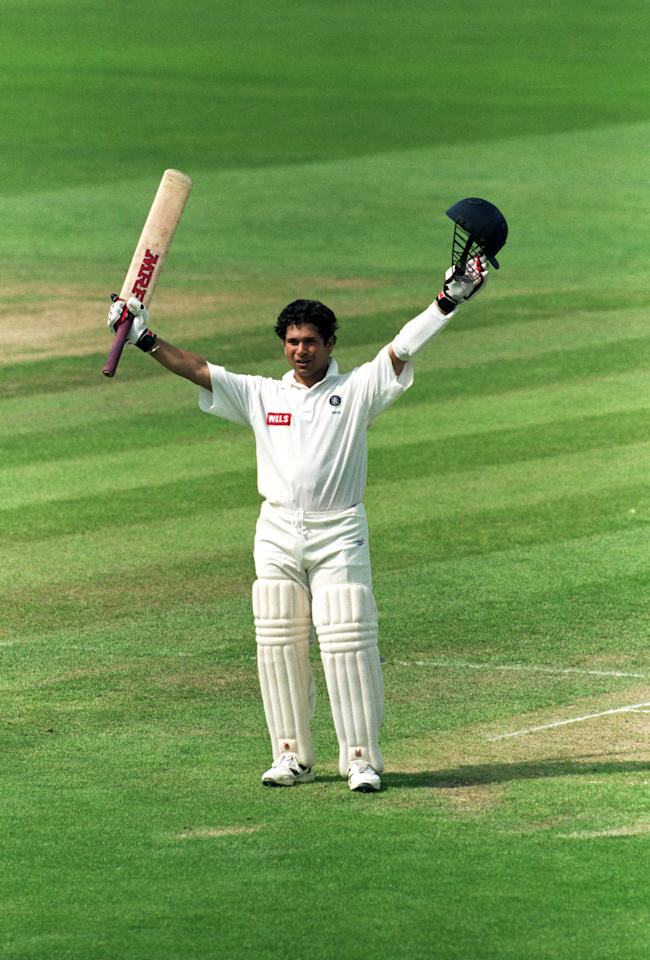 8 Jun 1996:  Sachin Tendulkar of India celebrates reaching his century during the First Test match against England played at Edgbaston, in Birmingham, England. \ Mandatory Credit: Adrian Murrell /Allsport