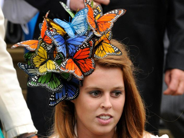 Princess Beatrice wears a fascinator with butterflies on it.