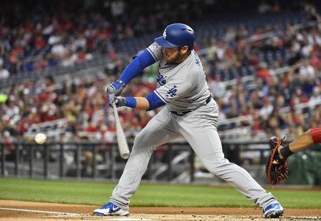 May 19, 2018; Washington, DC, USA; Los Angeles Dodgers first baseman Max Muncy (13) hits an RBI single against the Washington Nationals during the first inning at Nationals Park. Mandatory Credit: Brad Mills-USA TODAY Sports