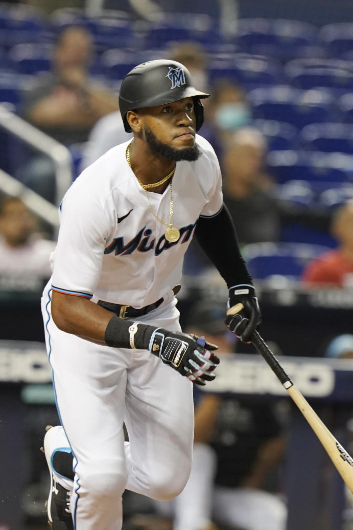 Miami Marlins' Bryan De La Cruz (77) hits a triple to right field during the sixth inning of a baseball game against the Washington Nationals, Wednesday, Sept. 22, 2021, in Miami. (AP Photo/Marta Lavandier)