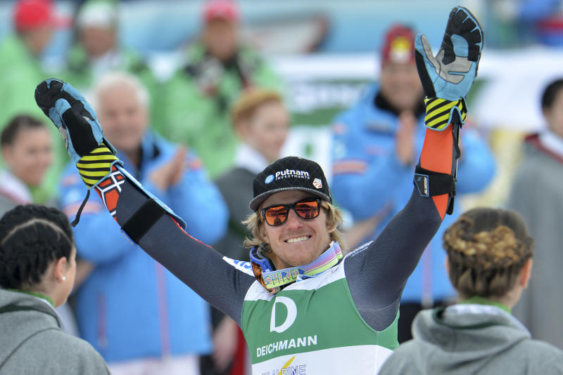 United States' Ted Ligety celebrates winning the gold medal after the men's giant slalom  at the Alpine skiing world championships in Schladming, Austria, Friday, Feb. 15, 2013. (AP Photo/Kerstin Joensson)