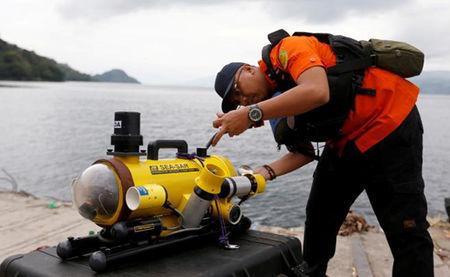 A rescue personnel prepares a ROV before starting to find the location of the Lion Air plane crash in the sea in Karawang regency, West Java province Indonesia, October 29, 2018. Antara Foto/Handout/Basarnas via REUTERS