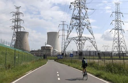 A man cycles towards Doel's nuclear plant, northern Belgium August 20, 2014. REUTERS/Francois Lenoir