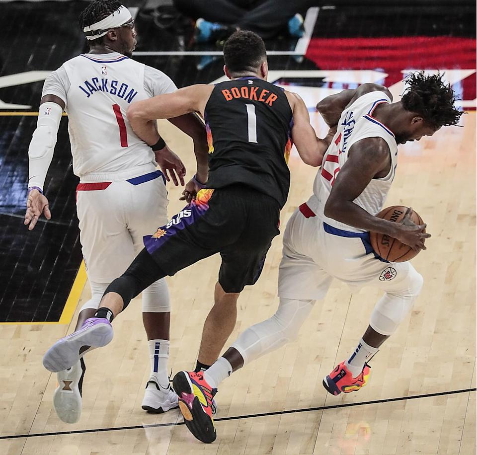 Clippers guard Patrick Beverley steals the ball from Suns guard Devin Booker during Game 2.