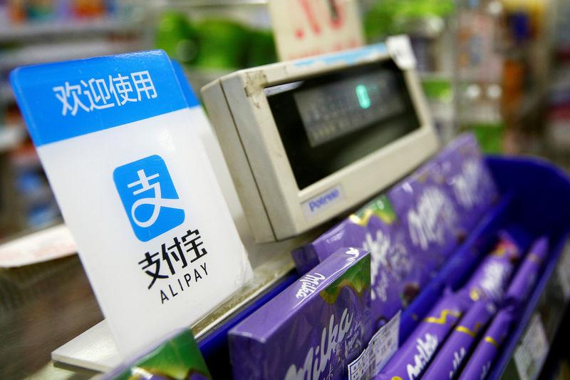 FILE PHOTO: An Alipay logo is seen at a cashier in Shanghai