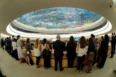 Delegates listens to the speech of new United Nations High Commissioner for Human Rights Michelle Bachelet during the Human Rights Council at the United Nations in Geneva, Switzerland, September 10, 2018. Picture taken with a fisheye lens. REUTERS/Denis Balibouse