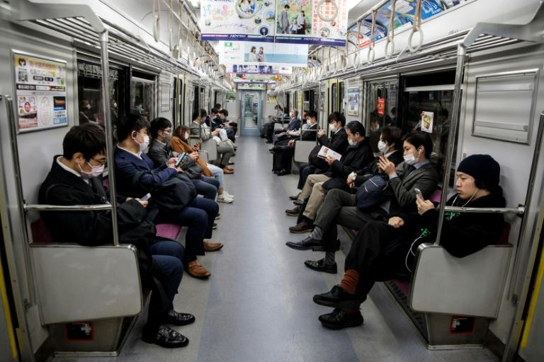 Tokyo's notoriously crowded transport system has been noticeably emptier in recent weeks (AFP Photo/Behrouz MEHRI)