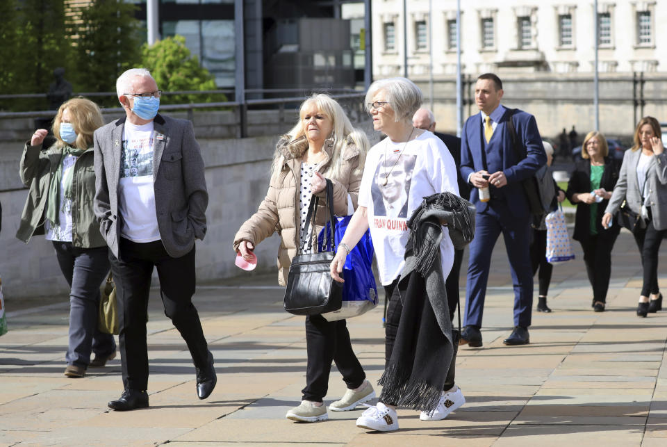 Relatives of Francis Quinn who was shot dead in the Ballymurphy shooting, arrive for the inquest into the shooting, in Belfast, Northern Ireland, Tuesday May 11, 2021. The findings of the inquest into the deaths of 10 people during an army operation in August 1971 is due to be published on Tuesday. (AP Photo/Peter Morrison)
