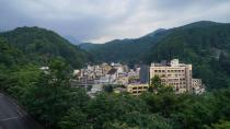 The town of Tsuchiyu Onsen Machi is seen embedded among the mountains