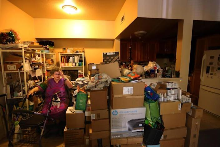 SANTA ROSA, CA - NOVEMBER 19, 2020 - Linda Adrain, 80, is surrounded by her belongings in her small 350 square foot apartment in Santa Rosa on November 19. 2020. Adrain lived in the Journey's End mobile home park that burned down in the Tubbs fire in Santa Rosa in 2017. Adrian is eligible for a new two-bedroom apartment once a new senior housing complex is built on the Journey's End site. But that development is expected to be years away from opening in part because they don't have enough money to build - something the federal relief dollars would remedy. There is more than $1 billion in federal relief dollars that have been allocated to wildfire victims in California from 2017 and 2018. None of that money has been spent yet. (Genaro Molina / Los Angeles Times)
