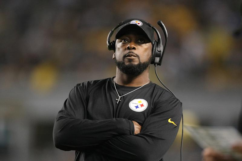 Pittsburgh Steelers head coach Mike Tomlin said his team would not be taking the field during the national anthem to avoid being looped in with politics.  (Jason Bridge/USA Today Sports via Reuters)