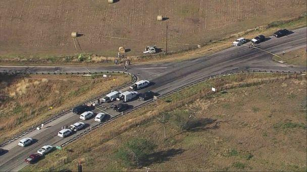 PHOTO: Police vehicles gather at the scene of the SUV where the suspected shooter who opened fire at First Baptist Church of Sutherland Springs, Texas, drove off the road and was found dead on Nov. 5, 2017.  (KSAT)