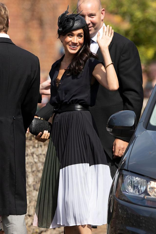"<p>Meghan celebrated her birthday (and Charlie van Straubenzee's wedding) in a colorful dress paired with a Philip Treacy fascinator. <a href=""https://www.townandcountrymag.com/style/fashion-trends/a22639732/meghan-markle-colorful-navy-dress-charlie-van-straubenzee-wedding/"" target=""_blank"">Get all the details right here.</a></p>"