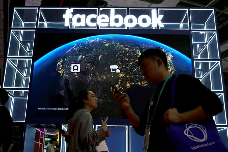 FILE PHOTO: A Facebook sign is seen at the second China International Import Expo (CIIE) in Shanghai,