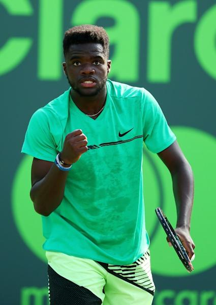 Frances Tiafoe of the US celebrates winning a point against Konstanin Kravchuk of Russia during their Miami Open first round match, at Crandon Park Tennis Center in Key Biscayne, Florida, on March 23, 2017