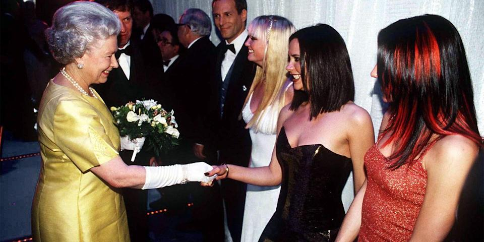 <p>Here she is in a yellow dress and white gloves for a meeting with the Spice Girls. </p>