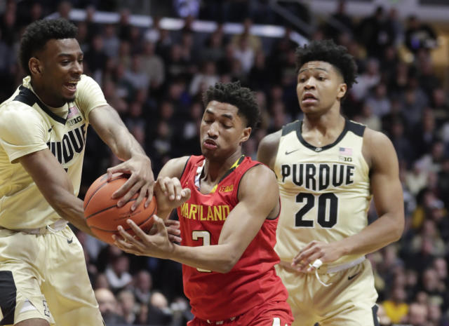 Maryland guard Aaron Wiggins (2) loses the ball to Purdue forward Aaron Wheeler, left, during the first half of an NCAA college basketball game in West Lafayette, Ind., Thursday, Dec. 6, 2018. (AP Photo/Michael Conroy)