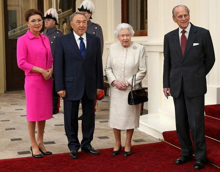 FILE PHOTO: Britain's Queen Elizabeth and Prince Philip (R) pose for a photograph with Kazakhstan's President Nursultan Nazarbayev (2nd L) and his daughter Dariga Nazarbayeva (L), at Buckingham Palace in London, Britain November 4, 2015.  REUTERS/Chris Jackson/Pool/File Photo