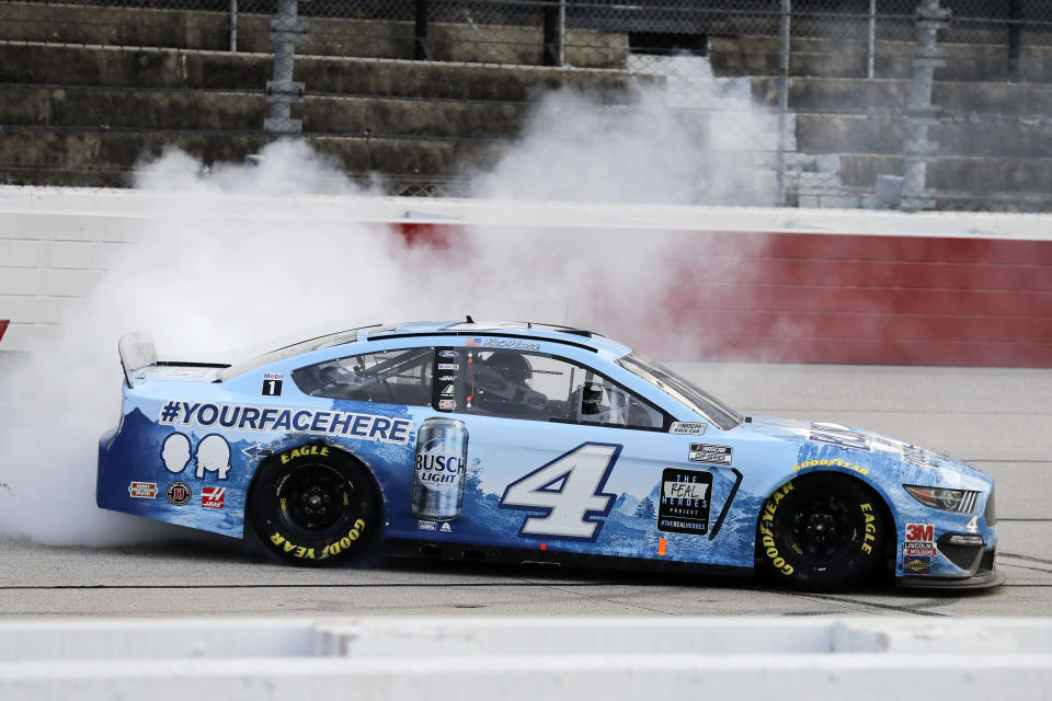 Kevin Harvick does a burnout after winning the NASCAR Cup Series auto race Sunday, May 17, 2020, in Darlington, S.C. (AP Photo/Brynn Anderson)