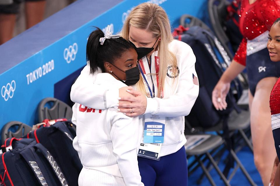 """<p>After the four-member U.S. squad won silver behind the ROC, Biles explained to reporters what forced her to withdraw from the team final.</p> <p>The athlete cited both her mental health — in particular, the rattling stress of this particular competition, in which she was seen by many as the face of Team USA — and the sudden onset of what she called the """"twisties,"""" when she lost her ability to sense her body move in the air.</p> <p>""""I was just dealing with some things internally which will get fixed out in the next couple of days,"""" she said, adding that she was worried her stress would negatively impact her performance and her team's chances to medal.</p> <p>Biles had """"withdrawn from the team final competition due to a medical issue. She will be assessed daily to determine medical clearance for future competitions,"""" USA Gymnastics said in a statement that night. Officials also said Biles' exit was """"in order to focus on her mental health.""""</p>"""