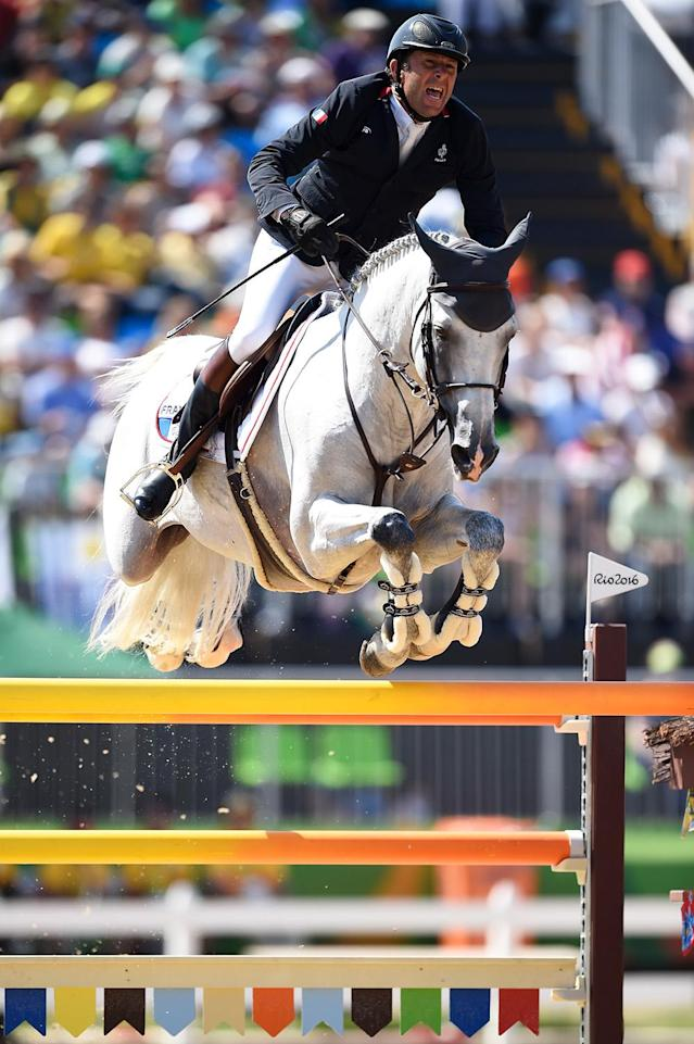 <p>Phillipe Rozier of France rides Rahotep De Toscane during the Jumping Team Round 2 during Day 12 of the Rio 2016 Olympic Games at the Olympic Equestrian Centre on August 17, 2016 in Rio de Janeiro, Brazil. (Photo by David Ramos/Getty Images) </p>