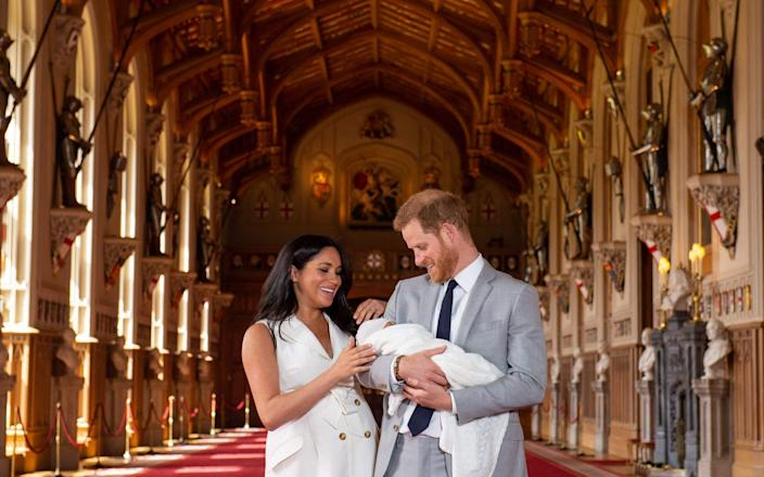 The Sussexes with their son Archie Harrison Mountbatten-Windsor shortly after his birth - AFP