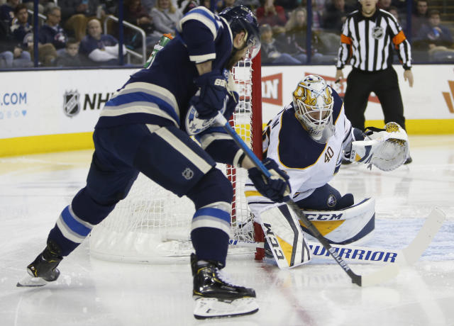 Buffalo Sabres' Carter Hutton, right, makes a save against Columbus Blue Jackets' Nick Foligno during the second period of an NHL hockey game Tuesday, Jan. 29, 2019, in Columbus, Ohio. (AP Photo/Jay LaPrete)
