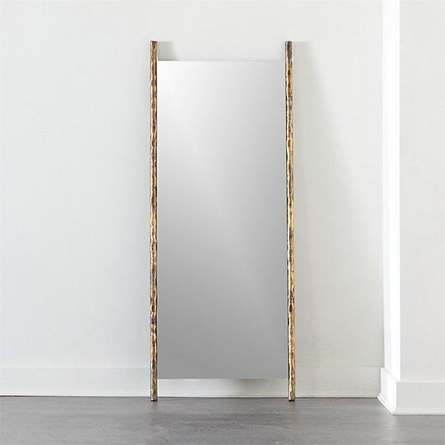 """The rustic hammered metal frame of this leaning mirror adds a uniquely sophisticated accent to any room. Because of its organic nature and ambiguous color, it can work with all kinds of styles. $479, CB2. <a href=""""https://www.cb2.com/abel-leaning-floor-mirror/s477008"""" rel=""""nofollow noopener"""" target=""""_blank"""" data-ylk=""""slk:Get it now!"""" class=""""link rapid-noclick-resp"""">Get it now!</a>"""