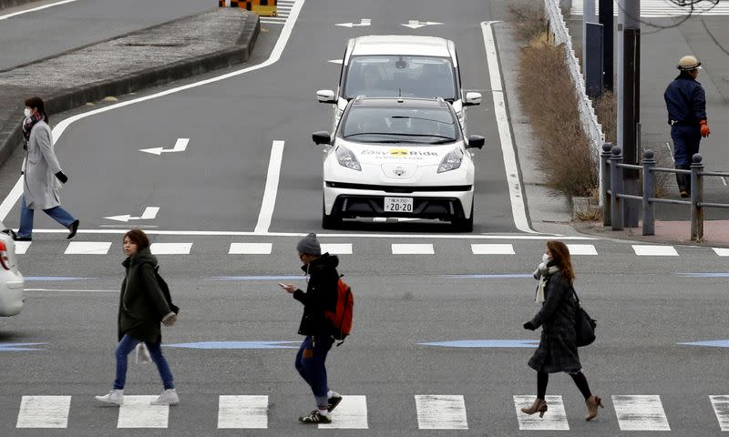 FILE PHOTO: A self-driving vehicle, based on Nissan Leaf EV, for Easy Ride service, developed by Nissan and mobile gaming platform operator DeNA Co, is seen during its media preview in Yokohama