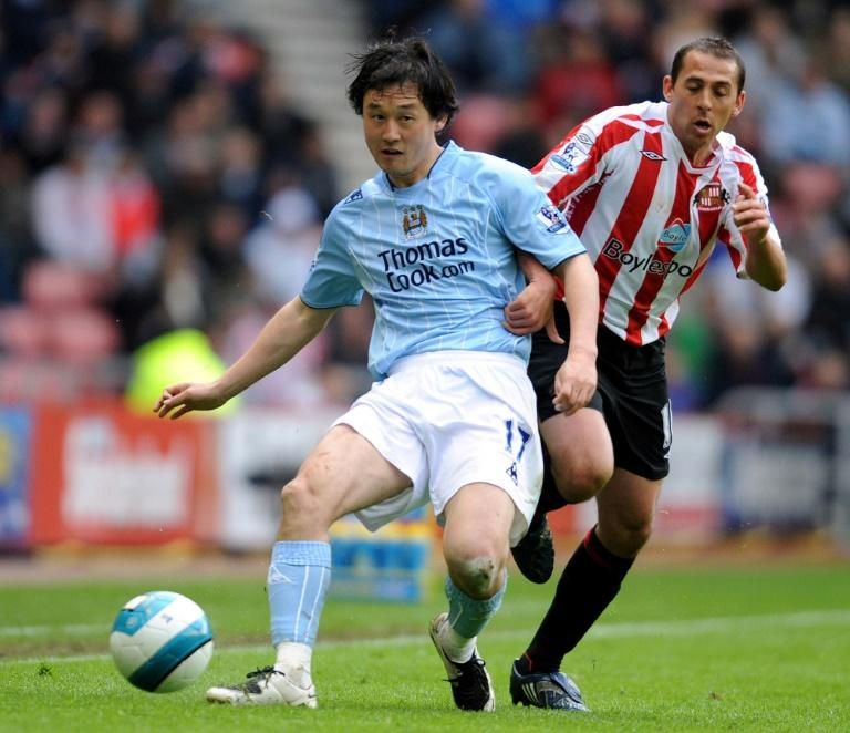 Sun Jihai (left) playing for Manchester City in 2008