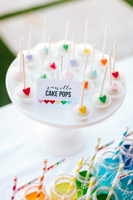 "<p><a rel=""nofollow"" href=""https://www.facebook.com/InspiredOccasionsAZ?fref=ts"">Inspired Occasions</a> made vanilla cake pops with minihearts for <a rel=""nofollow"" href=""https://www.popsugar.com/moms/Rainbow-Heart-Birthday-Party-30907808"">this rainbow-heart birthday party</a>.</p>"