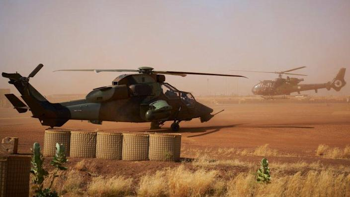 On November 8, 2019, the Eurocopter EC665 Tigre helicopter (L) can be seen at the French military base in Gao, northern Mali.