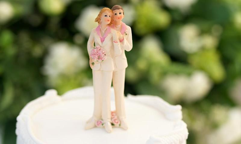 Figurines, depicting a gay wedding or Civil Partnership between two women, on top of a wedding cake