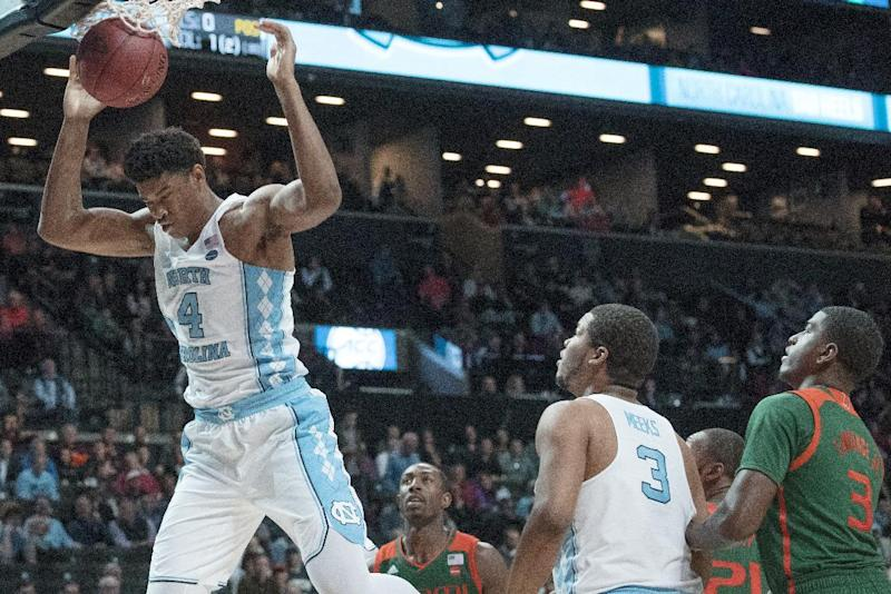 North Carolina forward Isaiah Hicks (4) dunks during the second half of an NCAA college basketball game against the Miami in the Atlantic Coast Conference tournament, Thursday, March 9, 2017, in New York. North Carolina won 78-53. (AP Photo/Mary Altaffer)