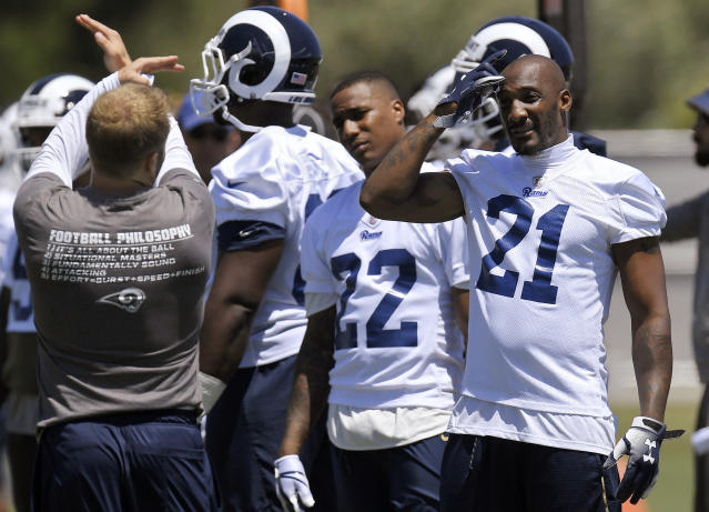 Los Angeles Rams coach Sean McVay, left, talks with cornerback Marcus Peters, center, and defensive back Aqib Talib during practice at the NFL football team's minicamp Tuesday, June 12, 2018, in Thousand Oaks, Calif. (AP Photo/Mark J. Terrill)