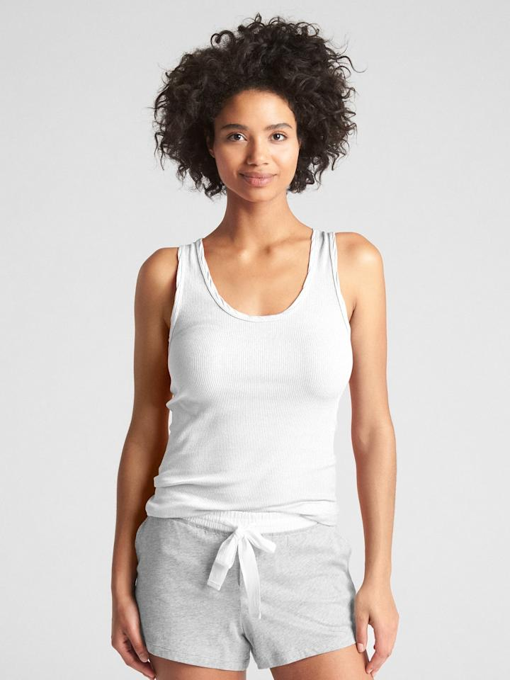 """<p>You can't go wrong owning this classic <a href=""""https://www.popsugar.com/buy/Gap-Forever-Favorite-Tank-Top-476737?p_name=Gap%20Forever%20Favorite%20Tank%20Top&retailer=gap.com&pid=476737&price=20&evar1=fab%3Aus&evar9=46467773&evar98=https%3A%2F%2Fwww.popsugar.com%2Fphoto-gallery%2F46467773%2Fimage%2F46468011%2FGap-Forever-Favorite-Tank-Top&list1=shopping%2Cgap%2Cunderwear%2Cloungewear&prop13=api&pdata=1"""" rel=""""nofollow"""" data-shoppable-link=""""1"""" target=""""_blank"""" class=""""ga-track"""" data-ga-category=""""Related"""" data-ga-label=""""https://www.gap.com/browse/product.do?pid=291480062&amp;cid=29504&amp;pcid=29504&amp;grid=pds_173_222_1&amp;cpos=182&amp;cexp=1161&amp;cid=CategoryIDs%3D29504&amp;ctype=Listing&amp;cpid=res19080710277035078162809#pdp-page-content"""" data-ga-action=""""In-Line Links"""">Gap Forever Favorite Tank Top</a> ($20).</p>"""